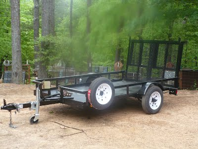 Motorcycle trailer with two pc extended ramp for easy loading
